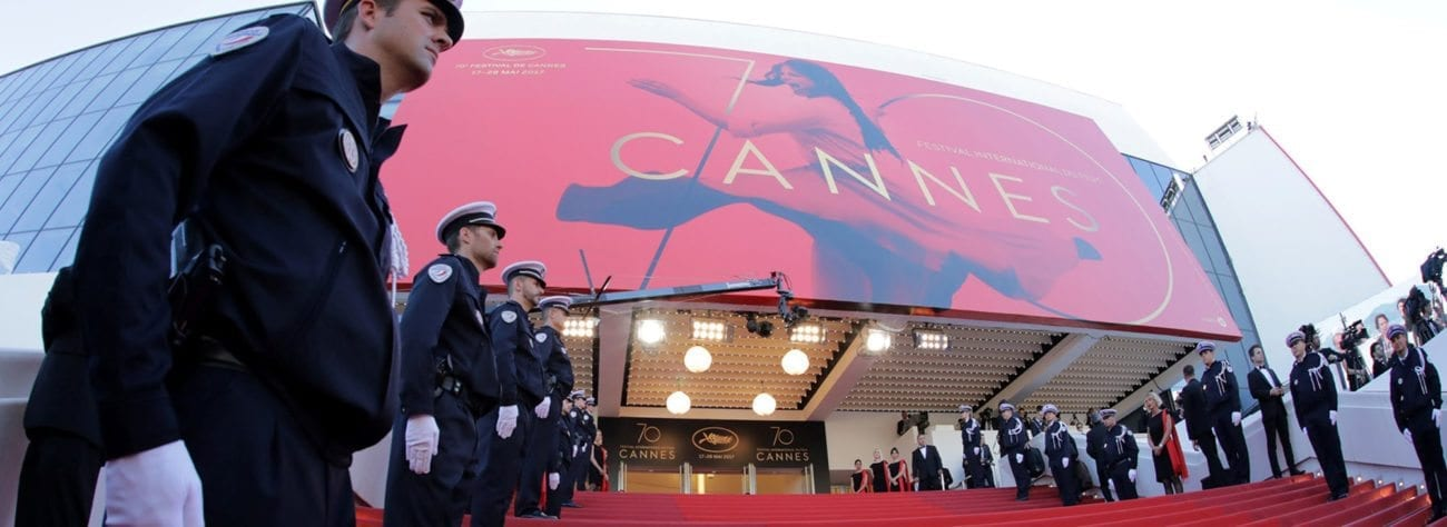 "Time to get those ""offended"" caps off the shelf, folks, because the official 2018 Cannes Film Festival poster is out and no doubt it's about to cause an uproar of Biblical proportions."
