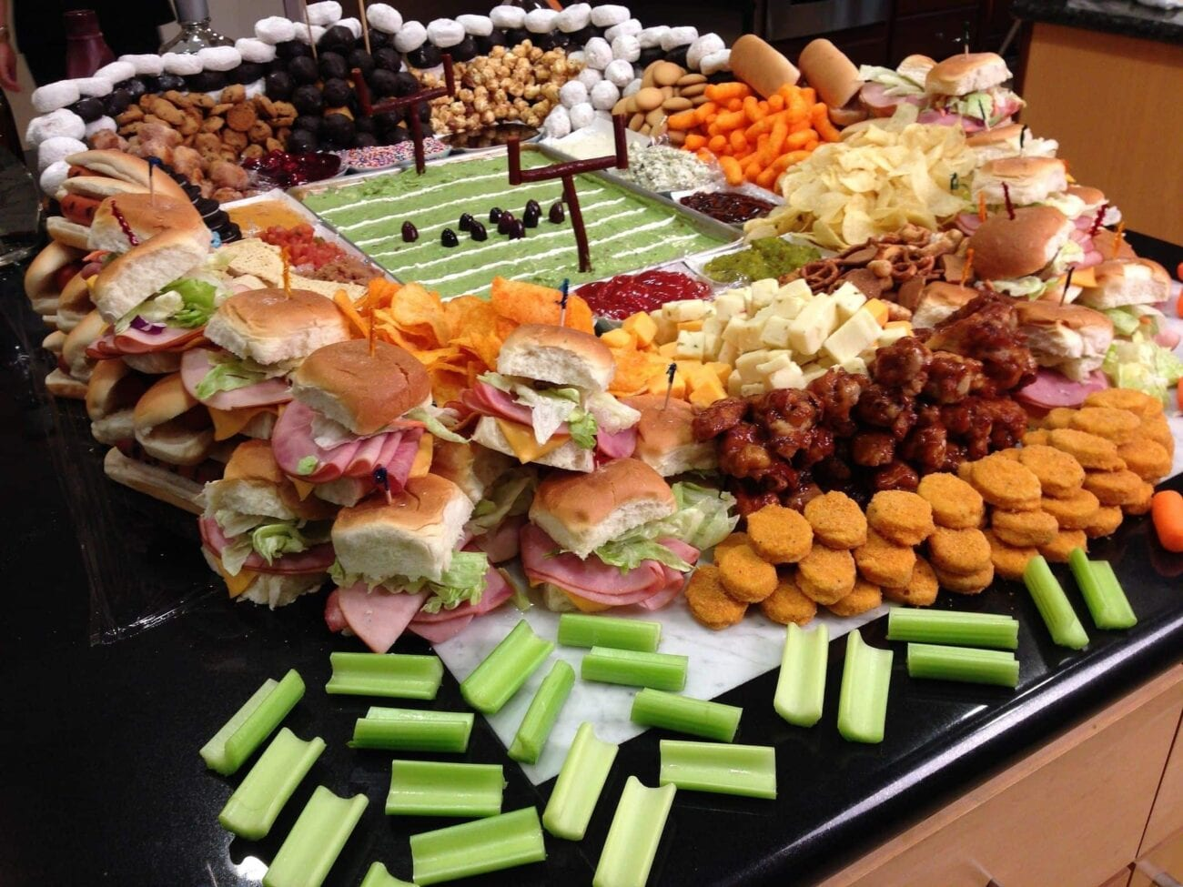 Yeah, sure, the Super Bowl is cool. But everybody knows the star of your party is the food. Score a touchdown with these football snacks staples!