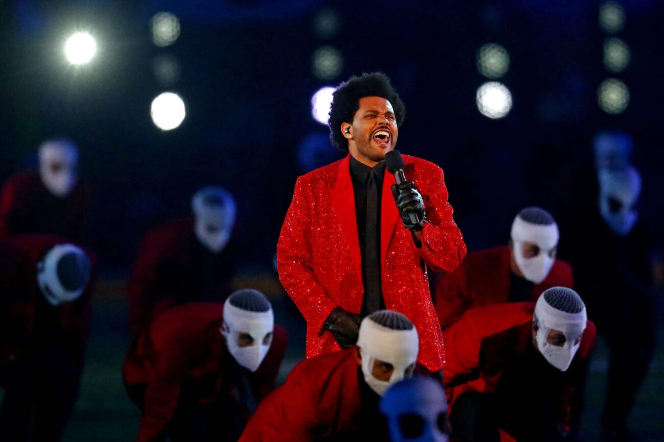 """Blinding Lights"" singer The Weeknd has had a steady stay in the headlines over the past year. Why did his dancers wear face bandages?"